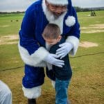 Child hugging Santa
