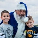 Children hugging Santa