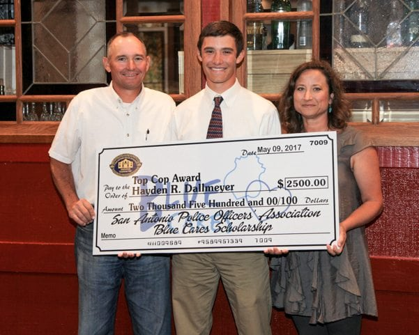 Scholarship recipients with their checks