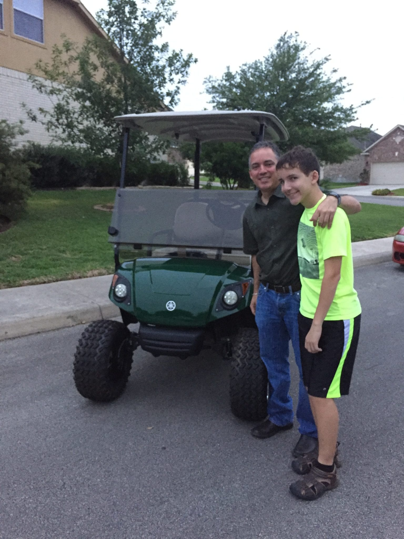 Golf Cart Winner, Ricardo Garza with his son.