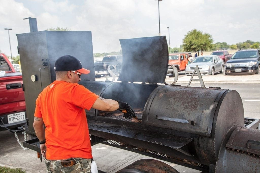 Law Enforcement Officers Give Back by grilling at charity event