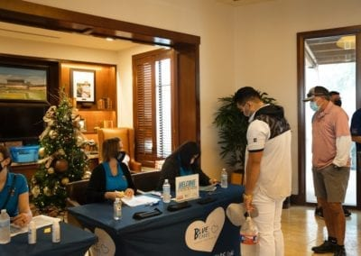 Blue Cares check in table at the 2020 Annual Golf Tournament